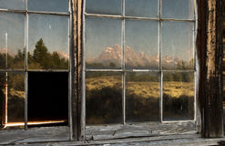 Mountains reflected in old window panes Royalty Free Stock Images