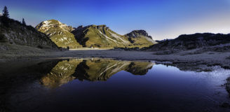 Mountains reflected in a small lake Royalty Free Stock Photo