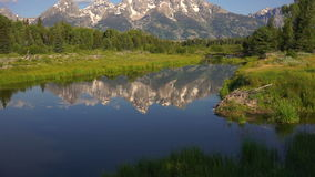Mountains Reflected Smooth Water Grand Teton National Park stock video footage