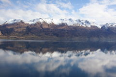 Mountains reflected in still lake Stock Photos