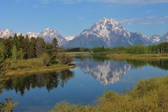 Mountains reflected in water. Mountains reflected on a river Royalty Free Stock Images