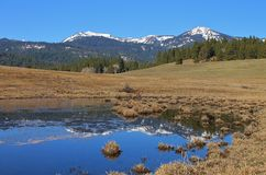 Mountains reflected on water. Snowy mountains reflected in water Royalty Free Stock Photo