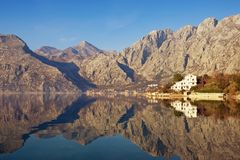 Mountains reflected in the water, winter Mediterranean landscape. Montenegro, Bay of Kotor. Mountains reflected in the water, winter Mediterranean landscape stock photo