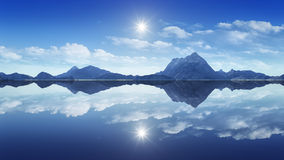 Mountains reflecting in the clear water Royalty Free Stock Images