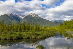 Mountains Reflecting in Lake - Banff National Park, Canada Stock Photo