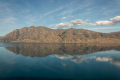 Mountains reflecting in lake Hawea Royalty Free Stock Photos