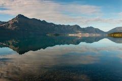 Mountains reflecting in lake Wakatipu Stock Image
