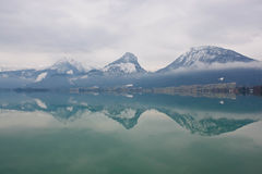 Mountains reflecting in a lake Wolfgangsee, Austria Royalty Free Stock Images