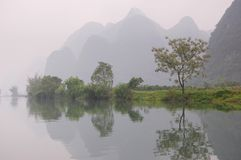 Mountains reflecting in the river Royalty Free Stock Photography