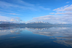Mountains reflecting in water. Under the blue sky, Ushuaia, Argentina stock photos