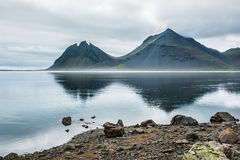 Mountains and reflection on the coast of the Atlantic ocean. Royalty Free Stock Photography