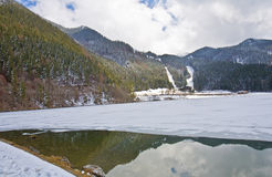 Mountains reflection in iced lake Royalty Free Stock Photo