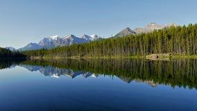 Mountains reflection in lake Stock Photos