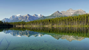 Mountains reflection in lake Stock Images