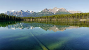 Mountains reflection in lake Stock Image