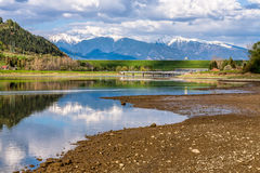 Mountains reflection in lake on spring sunny day, Slovakia. Mountains reflection in lake on spring sunny day, Liptov region, Slovakia. Butffer reservoir and dam Stock Photography