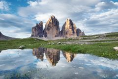 Mountains reflection on the water surface. Natural landscape in the Dolomites Alps in the Italy. Tre Cime di Lavaredo mountains stock photo