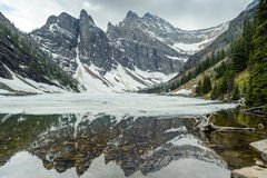 Mountains reflections in Agnes Lake Royalty Free Stock Photo