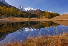 Mountains with reflections in a lake Stock Images