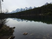 Mountains reflections. Rocky mountains and a lake Royalty Free Stock Photo