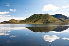 Mountains reflectng in the lake, clouds Stock Photo