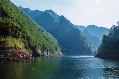 The mountains and reservoir scenery with blue sky Stock Images