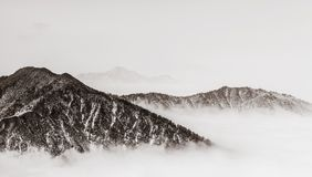 Mountains with retro style. Mountains landscape in clouds with retro style at xilin snow mountain, China Royalty Free Stock Photography