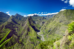 Mountains on Reunion Island. Scenic view of green mountains in Reunion Island National Park with blue sky and cloudscape background royalty free stock photography