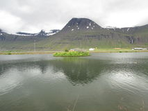 Mountains. This mountains are in Reydarfjordur, Iceland, this photo is taken by the towns pool, you can see the ducks if you look closely Royalty Free Stock Photo