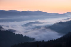 Mountains ridge at foggy morning Stock Photo