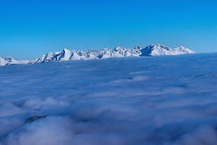 Snowy Mountains Tatras Slovakia. Snowy mountains covered with clouds Tatras Slovakia Stock Photography