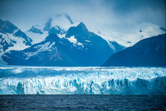 The mountains rise above the glacier bed. Shevelev. Royalty Free Stock Images