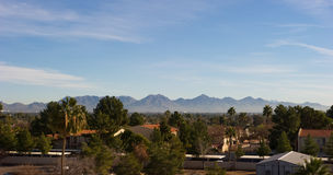 Mountains rising behind the suburbs of Phoenix Stock Images