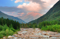 Mountains and river. High hill and the river in a mountain valley. Fresh spring composition Stock Photos