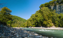 Mountains river. Mzymta River(Caucasus mountains, Russia) in Dzykhra Gorge. This place near Krasnaya Poluana ski resort (capital of the winter 2014 olimpyc royalty free stock photos