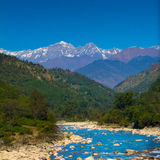 Mountains and river in India. River ganga turns near blue in winter . The green around the mountains look so amazing royalty free stock photography