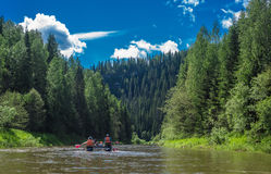 Mountains river and rafts Stock Images