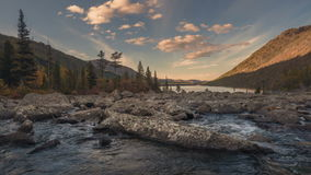 Mountains and river with a rapids flowing in a valley between mountain on a sunny autumn day timelapse, Siberia. Altai stock footage