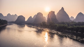 Mountains and River Sunrise View. Beautiful natural landscapes of sunrise in Guilin. Mountains and River Sunrise View at famous touristic City in China Passenger Stock Photography