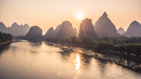 Mountains and River Sunrise View. Beautiful natural landscapes of sunrise in Guilin. Mountains and River Sunrise View at famous touristic City in China Passenger Royalty Free Stock Image