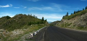 Mountains road. Panorama of highway bend in the mountains Royalty Free Stock Photos