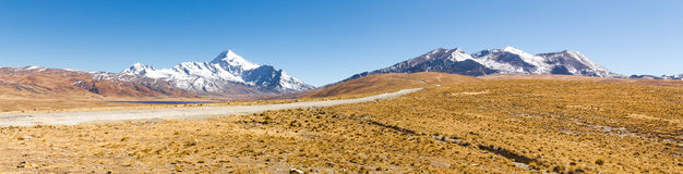 Mountains road  Chacaltaya Huayna Potosi summit snow peaks panorama. Royalty Free Stock Photo