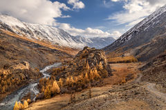 Mountains road river autumn sky Royalty Free Stock Photos