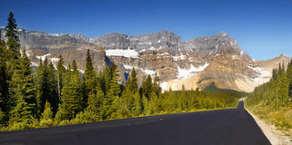 Mountains and Road. Summer view of mountains and scenic road on Icefield Parkway near Jasper. Alberta, Canada Royalty Free Stock Photo