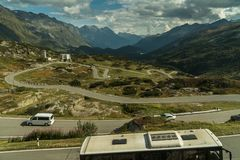Mountains road in switzerland alps with bus pullma royalty free stock photo