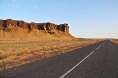 Mountains and road. The view of big road with big mountains all around Iceland Royalty Free Stock Photo