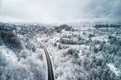 Mountains and road during in Winter royalty free stock images