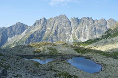 Mountains. Rock mountains and tarn in Slovakia Royalty Free Stock Photography