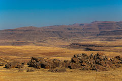 Mountains Rocks Dry Landscape. The Dry winter landscape in the Maluti mountains with lots of huge granite rocks all over the landscape in the valleys and hills Royalty Free Stock Images