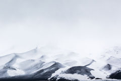 Mountains, rocks, ice, snow and mist Stock Images